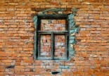 Old brick wall with wooden window