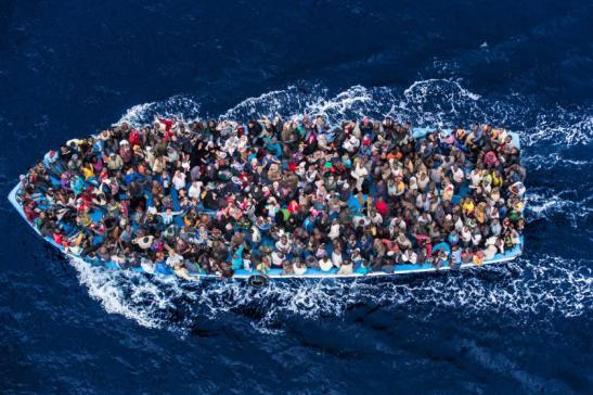 "June 7, 2014 - Mediterranean Sea / Italy: Italian navy rescues asylum seekers traveling by boat off the coast of Africa. More than 2,000 migrants jammed in 25 boats arrived in Italy June 12, ending an international operation to rescue asylum seekers traveling from Libya. They were taken to three Italian ports and likely to be transferred to refugee centers inland. Hundreds of women and dozens of babies, were rescued by the frigate FREMM Bergamini as part of the Italian navy's ""Mare Nostrum"" operation, launched last year after two boats sank and more than 400 drowned. Favorable weather is encouraging thousands of migrants from Syria, Eritrea and other sub-Saharan countries to arrive on the Italian coast in the coming days. Cost of passage is in the 2,500 Euros range for Africans and 3,500 for Middle Easterners, per person. Over 50,000 migrants have landed Italy in 2014. Many thousands are in Libya waiting to make the crossing. (Massimo Sestini/Polaris)"